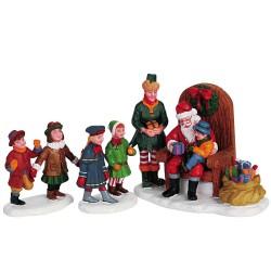 Enfants qui rencontrent le Père Noel