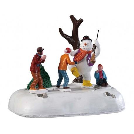 Bonhomme de neige et enfants qui dansent