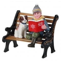Enfant et son chien sur un banc Lemax