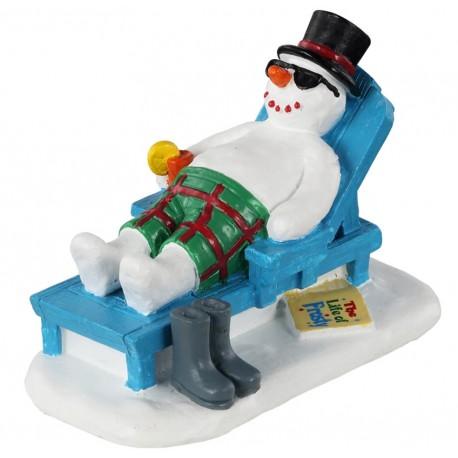 Bonhomme de neige sur chaise longue Lemax